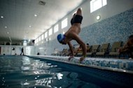 Afghan amputee Malek Mohammad trains in a swimming pool in Kabul. The 18-year-old, whose legs were blown off by a Soviet landmine, dreams of swimming for Afghanistan in the London Paralympics