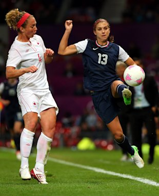 Alex Morgan is challenged by Carmelina Moscato in their Olympic semifinal match. (Getty Images)
