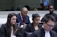 Former Liberian president Charles Taylor (rear C) waits for the start of the judgement hearing April 26, at the Special Court for Sierra Leone, in Leidschendam outside The Hague. Nations, rights groups and victims hailed a historic verdict after Taylor was convicted Thursday of aiding and abetting war crimes in Sierra Leone