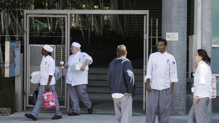 In this Sept. 1, 2011 photo, students stand near an entrance to the California Culinary Academy, which is part of the Le Cordon Bleu chain of for-profit cooking schools in San Francisco. The chain is coming under fire for its marketing practices as its graduates struggle to find culinary jobs and pay off their hefty student loans. Across the country, for-profit vocational schools are facing heavy criticism for former students who can't find jobs that pay enough to repay their student loans, most of which are subsidized by the federal government. (AP Photo/Eric Risberg)