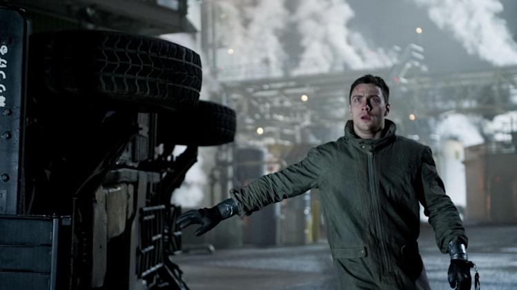 """This photo released by Warner Bros. Pictures shows Aaron Taylor-Johnson as Ford Brody in Warner Bros. Pictures' and Legendary Pictures' sci-fi action adventure, """"Godzilla,"""" a Warner Bros. Pictures release. The film opens in theaters May 16, 2014. (AP Photo/Warner Bros. Pictures/Legendary Pictures, Kimberley French)"""