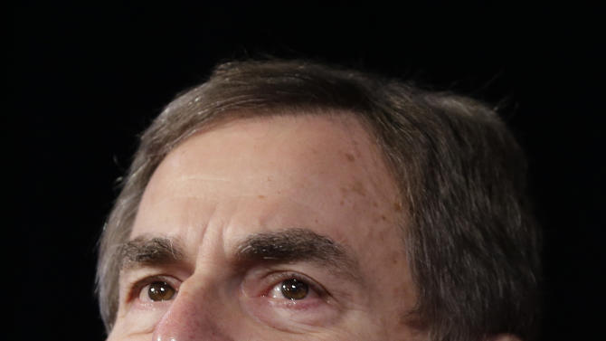 Republican Richard Mourdock, a candidate for Indiana's U.S. Senate, pauses as he speaks to supporters at an Indiana Republican Party Tuesday, Nov. 6, 2012, in Indianapolis. Mourdock was defeated by Democrat Joe Donnelly. (AP Photo/Darron Cummings)