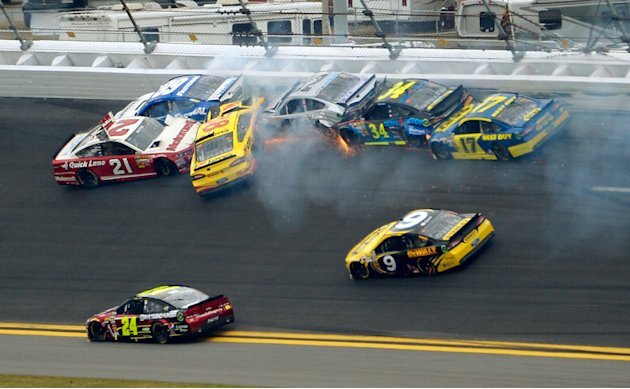 Trevor Bayne (21), Carl Edwards (99), David Gilliland (38), Terry Labonte (32), David Ragan (34) and Ricky Stenhouse Jr. (17) collide between Turn 1 and Turn 2 as Jeff Gordon (24) and Marcos Ambrose (