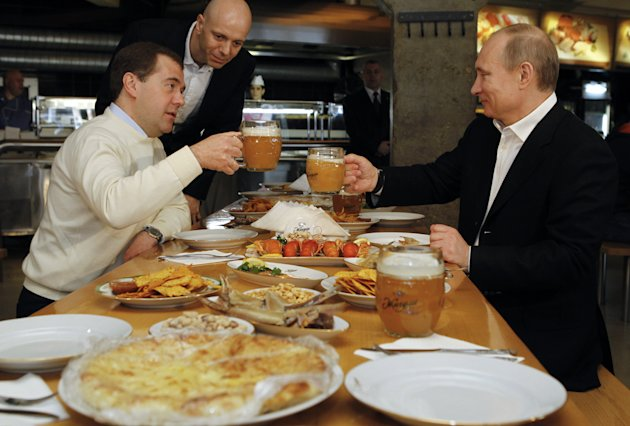 Russian President Dmitry Medvedev, left, and President-elect, Prime Minister Vladimir Putin, right, drink beer in the Zhiguli beer bar in Moscow, Tuesday, May 1, 2012.  President Dmitry Medvedev and P