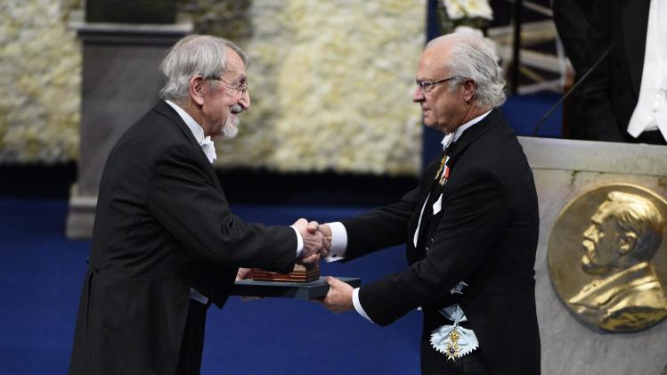 Martin Karplus receives his Nobel Prize in Chemistry from Sweden's King Carl Gustaf during the 2013 Nobel Prize award ceremony in Stockholm