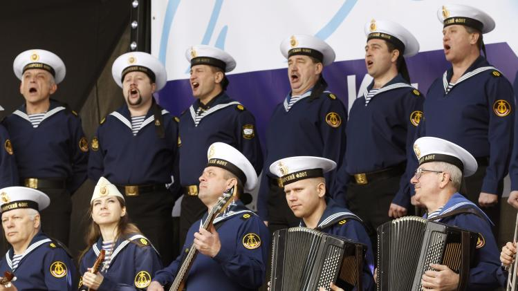 Members of the Russian Song and Dance Ensemble of the Black Sea Fleet perform during a pro-Russian rally in Simferopol
