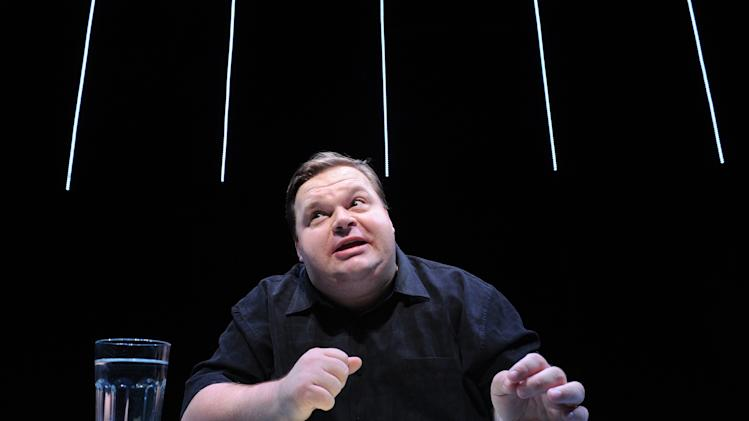 "In this undated image released by The Public Theater, Mike Daisey is shown in a scene from ""The Agony and The Ecstasy of Steve Jobs,"" in New York. Daisey, the performer forced to admit that he made up parts of his one-man show that looked at working conditions in Chinese factories where iPads and iPhones are assembled, is not slinking away. ""I want you all to know that I will not go silent,"" he writes in a new blog posting Monday following a torrid weekend in which he was exposed as mixing fiction and fact and had to edit his monologue. (AP Photo/The Public Theater, Stan Barouh)"
