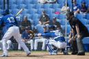 Toronto Blue Jays catcher Russell Martin, center, catches a strike from starting pitcher R.A. Dickey, not shown. as infielder Maicer Izturis (13) bats during the first inning of an intrasquad spring training baseball game in Dunedin, Fla., Monday, March 2, 2015. (AP Photo/The Canadian Press, Nathan Denette)