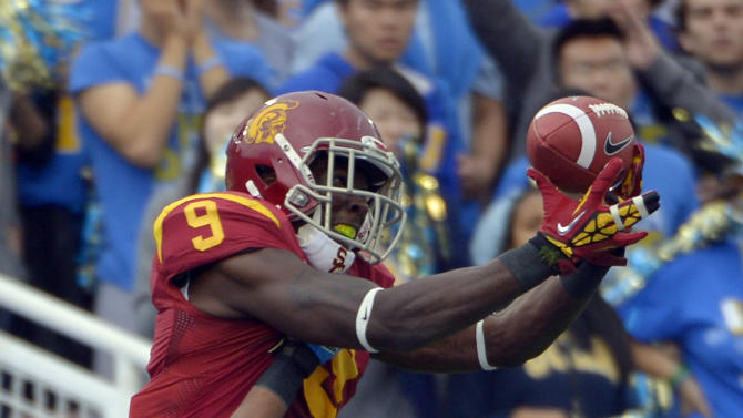 Southern California wide receiver Marqise Lee, left, can't hold on to a pass in the end zone as UCLA cornerback Sheldon Price defends during the first half of their NCAA college football game, Saturday, Nov. 17, 2012, in Pasadena, Calif. Price was called for pass interference on the play. (AP Photo/Mark J. Terrill)