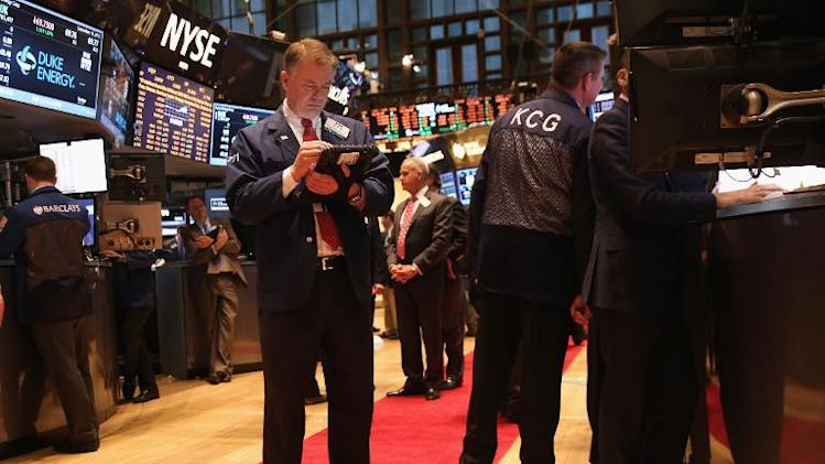 Traders work the floor of the New York Stock Exchange on December 18, 2013 in New York City