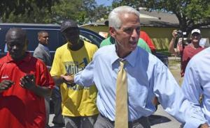 Former Florida Governor Charlie Crist greets supporters …