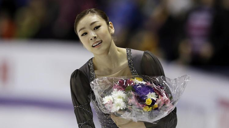 Kim Yu-na, of South Korea, smiles after her performance during the free skate program in the ladies competition at the World Figure Skating Championships Saturday, March 16, 2013, in London, Ontario. (AP Photo/Darron Cummings)