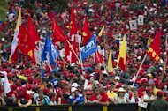Supporters of Venezuelan President Hugo Chavez gather outside the Miraflores Palace in Caracas, on January 10, 2013. Thousands of Venezuelans fervently swore 'absolute loyalty' to Chavez in a giant rally for the cancer-stricken president