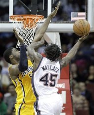 New Jersey Nets' Gerald Wallace (45) goes up for a shot against Indiana Pacers' Roy Hibbert in the second quarter of an NBA basketball game on Wednesday, March 28, 2012, in Newark, N.J. (AP Photo/Julio Cortez)
