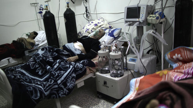 In this Tuesday, Dec. 18, 2012 photo, Syrian patients lie in their beds at an intensive care unit of a hospital in the village of Atmeh, Syria.(AP Photo/Muhammed Muheisen)