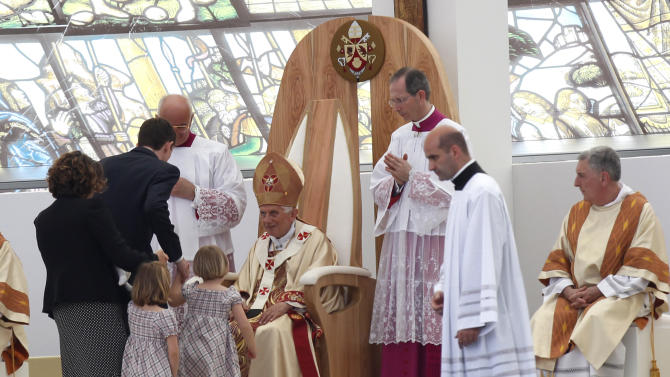 "Pope Benedict XVI greets a family as he celebrates a Mass in Bresso, near Milan, Italy, Sunday, June 3, 2012. Pope Benedict XVI has celebrated an open-air Mass before some 850,000 followers as part of three days of activities in Milan aimed at showing support for families. The pope in his homily Sunday took issue with modern economic thinking that he said ""creates ferocious competition, strong inequalities, degradation of the environment"" and reduces family relationships ""to fragile convergences of individual interests"" that undermine the social fabric. (AP Photo/Luca Bruno)"