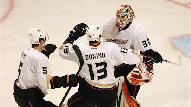 Luca Sbisa and Nick Bonino of the Anaheim Ducks celebrate with Viktor Fasth after beating the Chicago Blackhawks at the United Center (AFP)