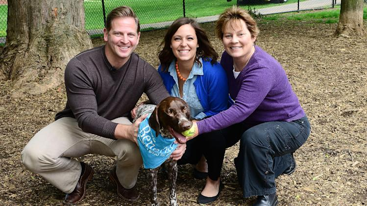 "IMAGE DISTRIBUTED FOR BENEFUL® BRAND DOG FOOD - Lancaster resident Angela Bauman (center) and her German Shorthaired Pointer ""Beau"" are joined by licensed contractor and TV personality Jason Cameron and dog expert Arden Moore to celebrate the $500,000 Dream Dog Park renovation of Buchanan Park Dog Park in Lancaster, PA on Tuesday, April 30, 2013. Beneful® brand dog food awarded the in-kind donation to the City of Lancaster after Bauman won the 2012 Beneful Dream Dog Park Contest. Cameron will manage the renovation and Moore will oversee the project from a dog's point of view. The renovated dog park will be unveiled in early August 2013. (Lisa Lake / AP Images for Beneful® brand dog food)"