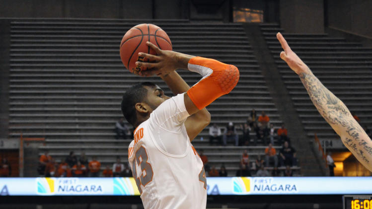 Syracuse's James Southerland scores against Detroit during the first half of an NCAA college basketball game in Syracuse, N.Y., Monday, Dec. 17, 2012. (AP Photo/Kevin Rivoli)