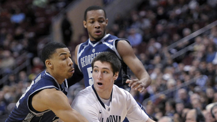 Georgetown's Otto Porter Jr., left, defends Villanova's Ryan Arcidiacono during the first half of an NCAA college basketball game, Wednesday, March 6, 2013, in Philadelphia. (AP Photo/Michael Perez)