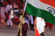 "Rifle shooter Abhinav Bindra carries the Indian flag during the XIX Commonwealth Games opening ceremony in 2010. ""Indian sports DETOX begins,"" tweeted Bindra, India's only individual Olympic gold medallist who won the 10m event at the 2008 Beijing Games"