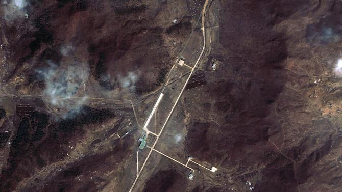 """This March 28, 2012 satellite image provided by DigitalGlobe shows North Korea's Tongchang-ri Launch Facility, including the launch pad, center left,  the rocket engine test stand, bottom, and the assembly building, top in green, on the nation's northwest coast.   An analysis of the March 28 images provided to The Associated Press by the U.S.-Korea Institute at Johns Hopkins School of Advanced International Studies shows Pyongyang """"has undertaken more extensive preparations for its planned April rocket launch than previously understood.""""  The new satellite images of the North Korean rocket launch site showed a mobile radar trailer and rows of what appear to be empty fuel and oxidizer tanks, evidence of ramped up preparation for what Washington calls a cover for a long-range missile test. (AP Photo/DigitalGlobe) MANDATORY CREDIT, NO SALES"""