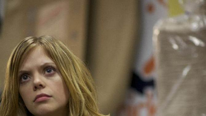 """FILE - This undated publicity file photo released by Magnolia Pictures shows Dreama Walker in a scene from the film, """"Compliance,"""" a Magnolia Pictures release. (AP Photo/Courtesy Magnolia Pictures, File)"""