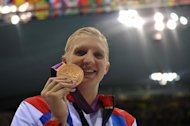 Rebecca Adlington with the Olympic women's 800m freestyle bronze medal she won in London last year. The popular Briton won two gold medals at the Beijing Games in 2008 but could only muster two bronze medals at London 2012 as the host nation's swimmers managed a disappointing three medals between them in the pool