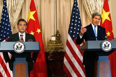 U.S. Secretary of State Kerry delivers remarks as China's Foreign Minister Wang looks on, before their meeting  in Washington