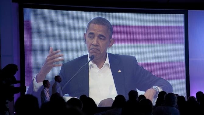 President Barack Obama is pictured on a large video screen during a three-way conversation with Brazil's President Dilma Rousseff and Colombia's President Juan Manuel Santos, not pictured, at the CEO Summit of the Americas in Cartagena, Colombia, Saturday April 14, 2012. Regional business leaders are meeting parallel to the sixth Summit of the Americas which brings together presidents and prime ministers from Canada, the Caribbean, Latin America and the U.S. (AP Photo/Carolyn Kaster)