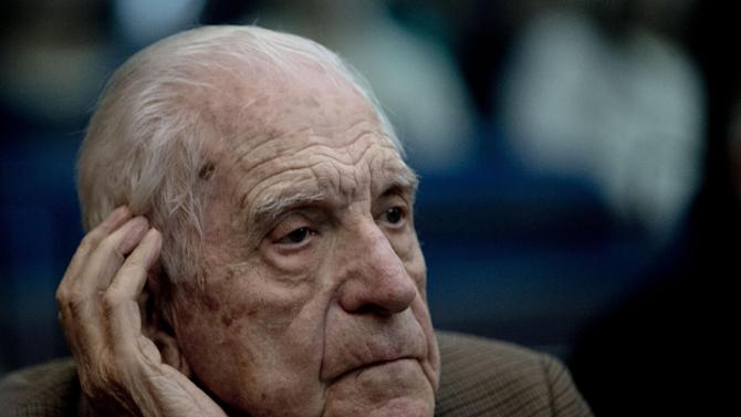 """Former dictator Reynaldo Bignone attends the first day of the trial for his alleged involvement in the so called operation, """"Plan Condor,"""" in Buenos Aires, Argentina, Tuesday, March 5, 2013. Argentina began today its first human rights trial focused on the joint operation by the southern cone's 1970s dictatorships to track down leftists in each other's countries. Bignone has already been sentenced to life imprisonment for crimes against humanity. (AP Photo/Natacha Pisarenko)"""