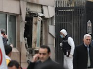 Turkish police and forensic experts inspect the site of a blast outside the US embassy in Ankara, on February 1, 2013. The United States has sent an FBI team to join the Turkish investigation into a deadly suicide bombing on the US embassy in Ankara last week
