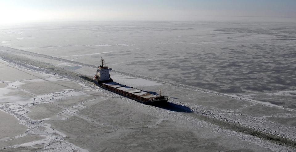 "In this aerial photograph taken Monday, Feb. 6, 2012, the ""Botnia"" freighter navigates a waterway forged through the ice in the Baltic Sea by the ""Goermitz"" icebreaker, near the coast of Thiessow, Germany. (AP Photo/dapd/Jens Koehler)"