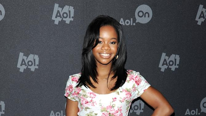 """Olympic gymnast Gabby Douglas attends AOL's web series """"NewFront"""" at Moynihan Station on Tuesday April 30, 2013 in New York. (Photo by Evan Agostini/Invision/AP)"""