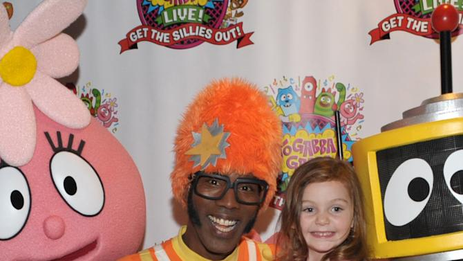 DJ Lance Rock, left, greets fans at Yo Gabba Gabba! Live!: Get The Sillies Out! 50+ city tour kick-off performance on Thanksgiving weekend at Nokia Theatre L.A. Live on Friday Nov. 23, 2012 in Los Angeles. (Photo by John Shearer/Invision for GabbaCaDabra, LLC./AP Images)