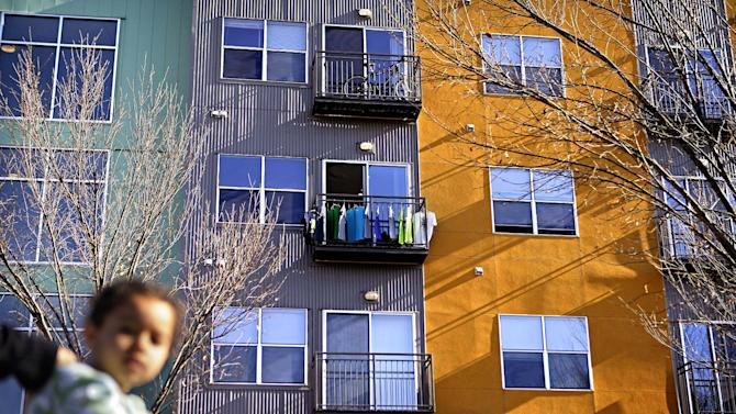 In this Nov. 20, 2012 photo, shirts hang on a balcony of a modern apartment complex along the Atlanta BeltLine in Atlanta. Since an Atlanta nonprofit opened a 2.25-mile-long paved trail east of downtown last month, it has attracted a steady stream of joggers, dog-walkers and cyclists to take in spectacular views of the skyline as well as a slice of established neighborhoods that were once only seen by riding a freight train. The Eastside Trail is the latest and most visible phase of the Atlanta BeltLine, an ambitious $2.8 billion plan to transform a 22-mile railroad corridor that encircles Atlanta into a network of parks, trails, public art, affordable homes and ultimately streetcars. (AP Photo/David Goldman)