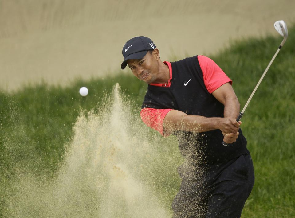 Tiger Woods hits out of a bunker on the second hole during the fourth round of the U.S. Open Championship golf tournament Sunday, June 17, 2012, at The Olympic Club in San Francisco. (AP Photo/Eric Risberg)