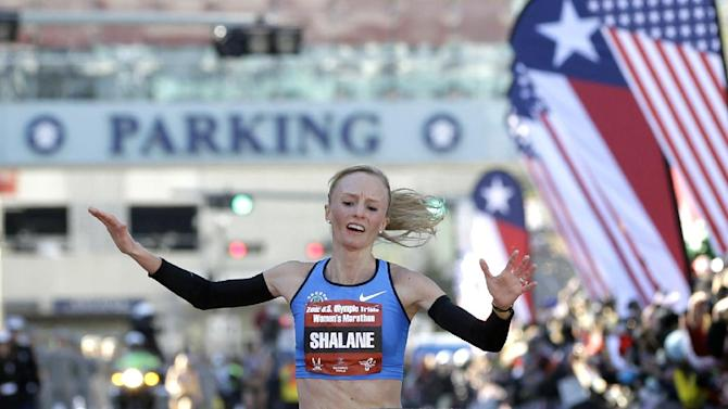 FILE - In this Jan. 14, 2012, file photo, Shalane Flanagan reacts as she crosses the finish line to win the U.S. Olympic Trials women's marathon in Houston. Flanagan grew up in nearby Marblehead, Mass., watching her parents run in the Boston Marathon. When she heads to the starting line on Monday, she'll be the best chance at an American winner, the first since 1985. (AP Photo/David J. Phillip, File)