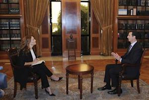 Syria's President Bashar al-Assad speaks during an interview with Italian television station RaiNews24 in Damascus