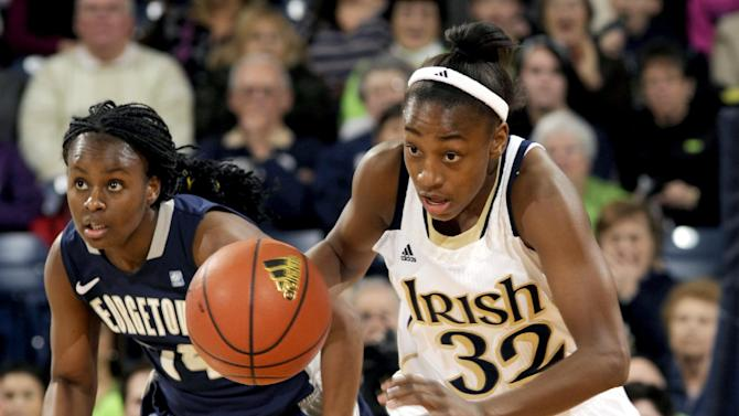 Notre Dame guard Jewell Loyd (32) heads upcourt as Georgetown's Sugar Rodgers gives chase during the first half of an NCAA college basketball game, Tuesday, Jan. 15, 2013, in South Bend, Ind. (AP Photo/Joe Raymond)