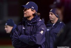 Skaneateles football coach and former NFL linebacker Tim Green in action