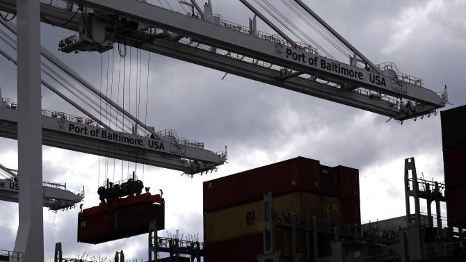 In this March 1, 2013 photo, a crane removes a container from a ship at the Port of Baltimore's Seagirt Marine Terminal in Baltimore. The U.S. trade deficit unexpectedly narrowed in February as exports climbed close to an all-time high and the volume of imported crude oil fell to the lowest level in 17 years, according to information released by the Commerce Department, Friday, April 5, 2013. (AP Photo/Patrick Semansky)