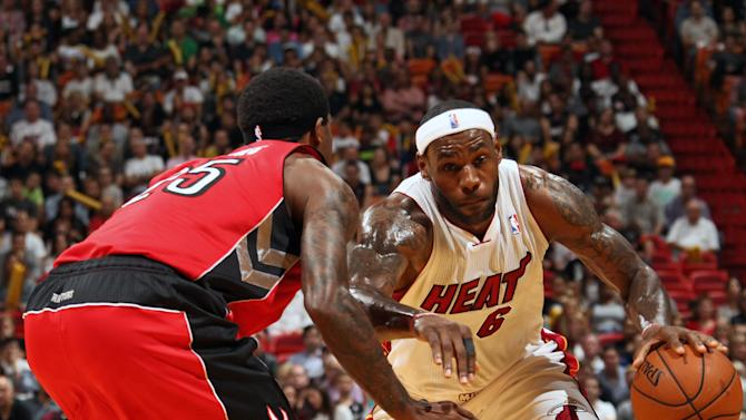 James scores 30, Heat top Raptors 102-97