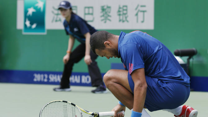 Jo-Wilfried Tsonga of France reacts after losing a point to Tomas Berdych of the Czech Republic during their men's singles quarterfinal match at the Shanghai Masters tennis tournament at Qizhong Forest Sports City Tennis Center in Shanghai, China, Friday Oct. 12, 2012. Tomas Berdych won 6-3, 7-6 (4). (AP Photo/Kin Cheung)