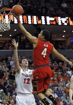 Tobey's OT tip lifts Virginia past Maryland, 61-58