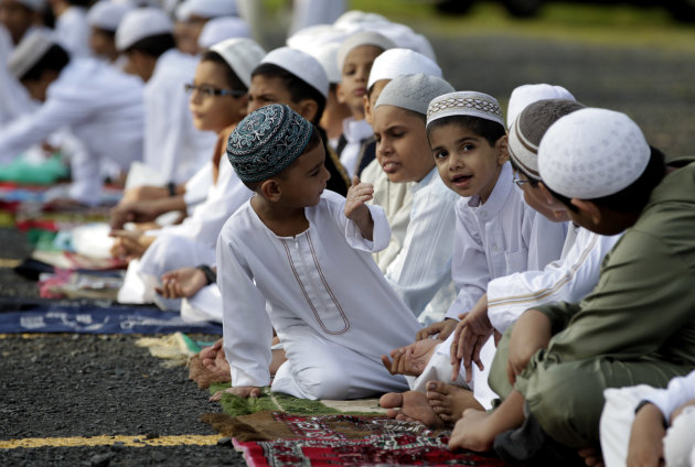 Muslims children attend Eid al-Fitr prayer, which marks the end of the holy month of Ramadan in Panama City, Sunday, Aug. 19, 2012. Muslims around the world celebrate Eid al-Fitr, marking the end of R