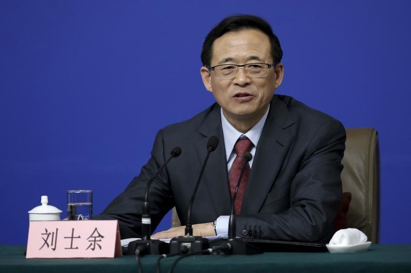 """China securities regulator chairman condemns """"barbaric"""" company buy-outs by asset managers"""