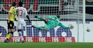 Augsburg&#39;s goalkeeper Simon Jentzsch (R) saves the ball during their German first division Bundesliga match vs Borussia Dortmund, in Augsburg, southern Germany, on March 10. Augsburg play Bayern Munich next, at Allianz Arena, on Saturday