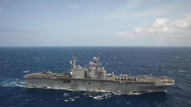 In this April 5, 2013 image provided by the U.S. Navy the amphibious assault ship USS Peleliu transits the Pacific Ocean. The Navy diverted the USS Peleliu, Sunday April 28, 2013, that was headed homeward, to assist in the search for a missing 35-year-old British man who fell overboard from a 38-foot sailboat 500 miles west of the Midway Atoll. (AP Photo/US Navy)  (U.S. Navy photo by Mass Communication Specialist 3rd Class Michael Duran/Released)