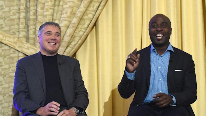 Former NFL players Mick Luckhurst, left, and Marshall Faulk speak during the NFL International Series Fan Forum at a hotel in London, England, Saturday, Oct. 25, 2014. The Atlanta Falcons will play the Detroit Lions in an NFL football game at London's Wembley Stadium on Sunday Oct. 26